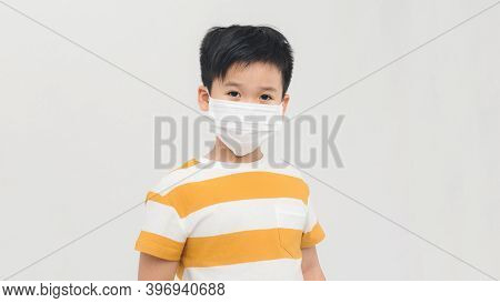 Brave Teen Boy With Medical Mask Standing With Courageous Face  Isolated On White. Childhood, Stylis