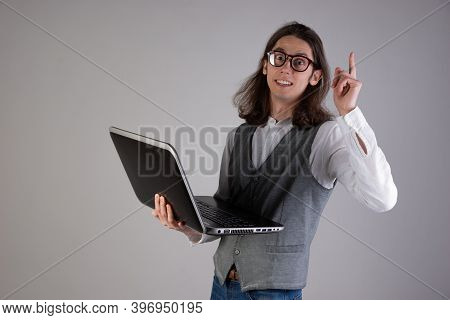 Training And New Technologies, Online Courses, E-learning. A Young Man With Long Hair And Glasses. A