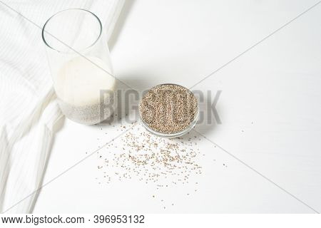 White Chia Seeds On A Light Background, Dry Chia In A Glass Plate, Vegetarian Healthy Food With Omeg