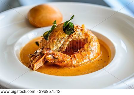 Main Course Of King Prawn Served In Bang Sauce With A Bun