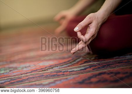 Detail Of Hands While Meditation. Woman Practicing Yoga Concept Natural Balance Between Body And Men