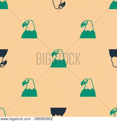 Green And Black Eagle Head Icon Isolated Seamless Pattern On Beige Background. Animal Symbol. Vector