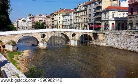 Sarajevo, Bosnia And Herzegovina - June 25, 2017: Latin Bridge And The Houses On The River In Saraje