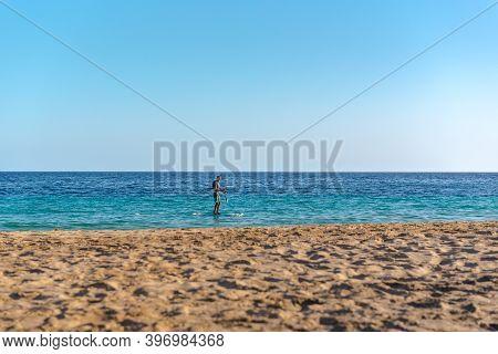 Morro Jable, Fuerteventura, Spain: 2020 October 08: Man Paddle Surfing From Morro Jable On Fuerteven