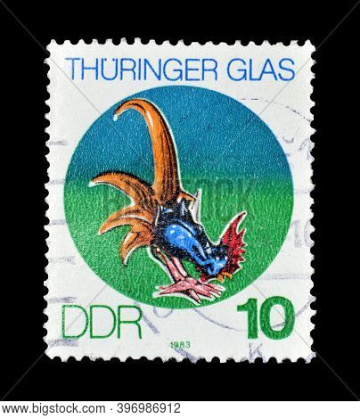 East Germany - Circa 1983 : Cancelled Postage Stamp Printed By East Germany, That Shows Cock Made Of