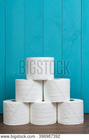 Some Rolls Of Toilet Paper On A Wooden Table