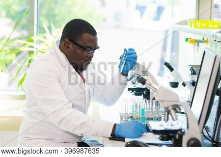 African-american Medical Doctor Working In Research Lab. Science Assistant Making Pharmaceutical Exp