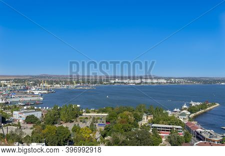 Kerch, Crimea - September 16, 2020: Panorama Of Sea Port With Working Cranes, Docks And Ships.