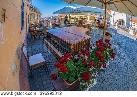 Sibiu, Transylvania, Romania - July 8, 2020: Decorative Street Piano, Located At One End Of The Brid