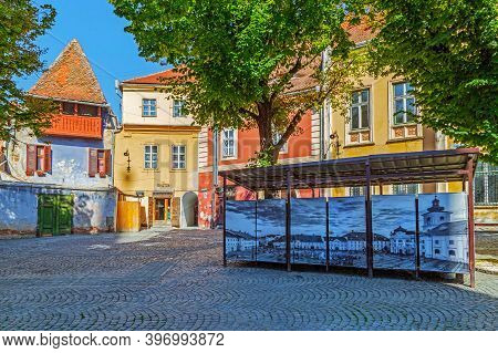 Sibiu, Transylvania, Romania - July 8, 2020: Huet Square, With Old Period Pictures And Historical Bu