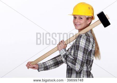 Tradeswoman carrying a mallet