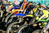 row of motobikes close up at wheels poster