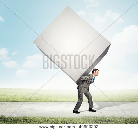 Image of businessman carrying big white cube on his back poster