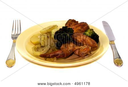 Fried Potato And Chicken On Plate