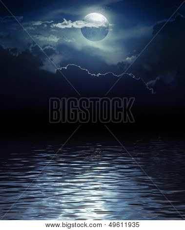 Fantasy Moon and Clouds over water (Elements of this image furnished by NASA)