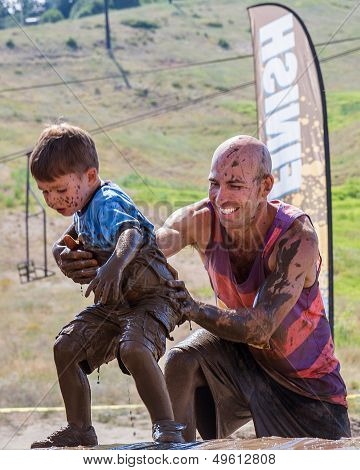 Father helping his son during the race