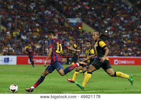 KUALA LUMPUR - AUGUST 10: FC Barcelona's Neymar (11) shoots at goal against the Malaysian team at the Shah Alam Stadium on August 10, 2013 in Malaysia. FC Barcelona wins 3-1.