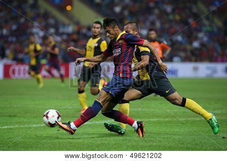 KUALA LUMPUR - AUGUST 10: FC Barcelona's Neymar Jr. (maroon/blue) shoots at goal in a match against Malaysia at the Shah Alam Stadium on August 10, 2013 in Malaysia. FC Barcelona wins 3-1.
