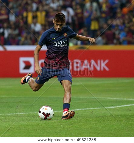KUALA LUMPUR - AUGUST 10: FC Barcelona's player Neymar strikes during warm-up before the match against Malaysia at the Shah Alam Stadium on Aug 10, 2013 in Malaysia. FC Barcelona wins 3-1.