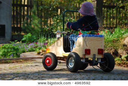 Boy Driving Selfmade Car