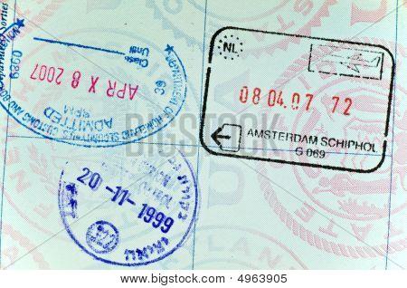 Visa Stamps On Page Of Usa Passport
