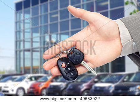 Hand giving a car key. Auto repair service. poster