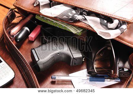 A gun in a purse