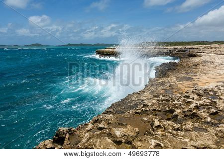 Waves Crashing Over Coastline At Devil's Bridge Antigua