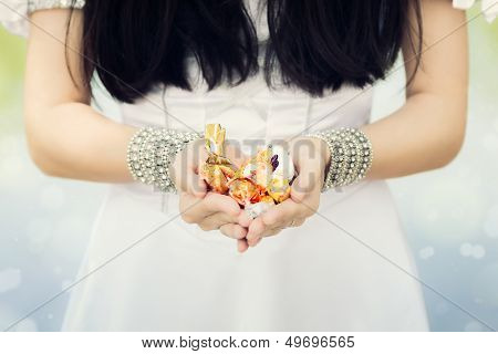 Girl's Hands Holding Candy