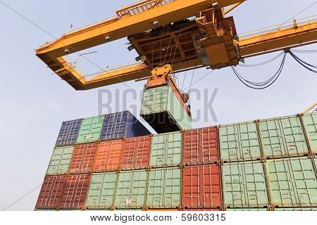 A Big Container Vessel In A Container Seaport During Transportation Of Cargo In Containers By Cranes
