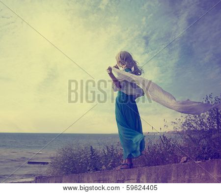 Lonely Woman in Turquoise Dress with Waving Scarf
