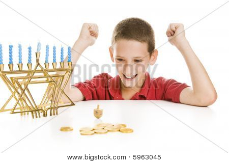 Boy Spinning The Chanukah Dreidel