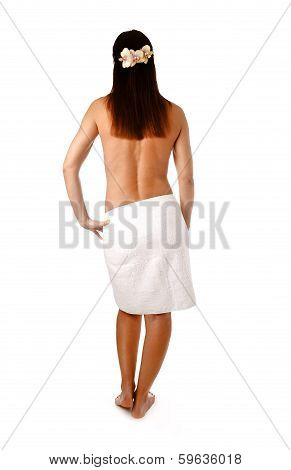 woman from behind standing in towel