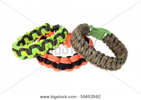 Genuine Para shoot Cord Survival Bracelets. Survival Bracelets AKA Wrist Bands are perfect for any hunter, camper, Dooms Day Expert and more. Isolated on white with room for your text.