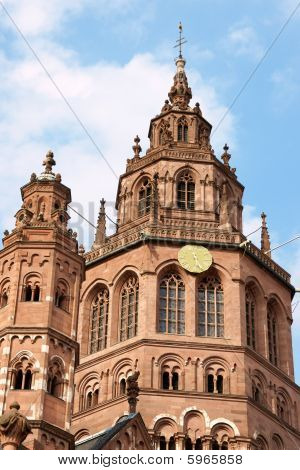 In the old town of Mainz rises the six towers of St. Martin's Cathedral (German: Mainzer Dom) that represents the highest point of Romanesque cathedral architecture in Germany. The Cathedral of Mainz dates from 975 AD but was continually rebuilt and  poster