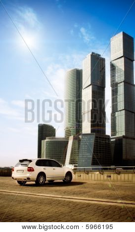 Business center and luxury car on foreground.