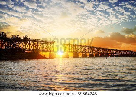 Colorful Sunset Or Sunrise With Broken Bridge
