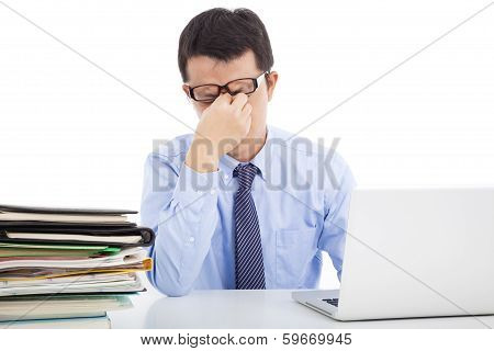 Businessman Is Too Overwork To Rubbing His Eyes