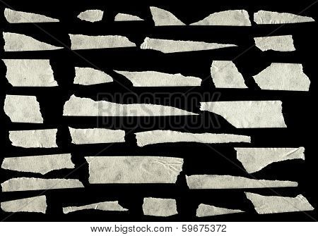 Strips of masking tape isolated on black background poster