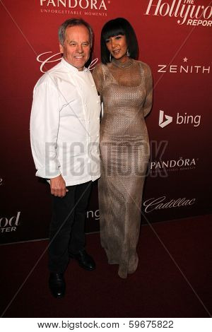 LOS ANGELES - FEB 10:  Wolfgang Puck, Gelila Assefa at the The Hollywood Reporter's Annual Nominees Night Party at Spago on February 10, 2014 in Beverly Hills, CA