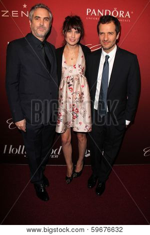 LOS ANGELES - FEB 10:  Alfonso Cuaron, Sheherazade Goldsmith, Guest at the The Hollywood Reporter's Annual Nominees Night Party at Spago on February 10, 2014 in Beverly Hills, CA