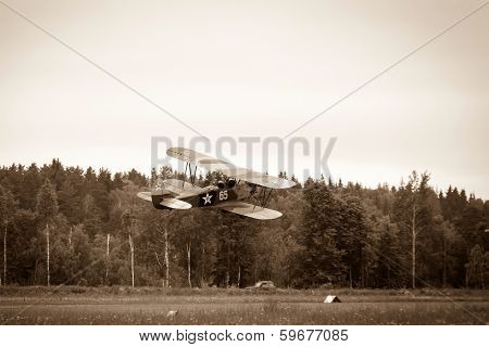 biplane Polikarpov Po-2 on the background of the cloudy sky, the aircraft  WW2 poster