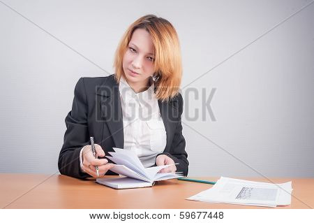 Young red-haired businesswoman