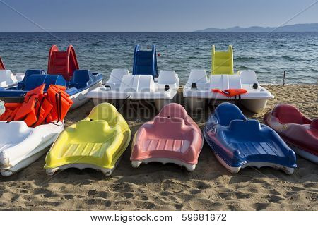 Plastic Boats In Different Colors, On The Seashore