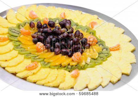 Fresh sliced fruit on the tray isolated