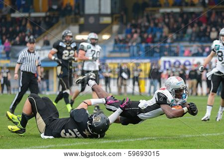 WIENER NEUDORF,  AUSTRIA - APRIL 20 RB Jaycen Taylor Spears (#7 Raiders) scores a touchdown during the AFL football game on April 20, 2013 in Wiener Neudorf, Austria.