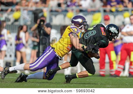 VIENNA,  AUSTRIA - APRIL 21 DL Florian Gr���¼nsteidl (#94 Vikings) sacks QB Jonathan Dally (#8 Dragons) during the AFL football game on April 21, 2013 in Vienna, Austria.