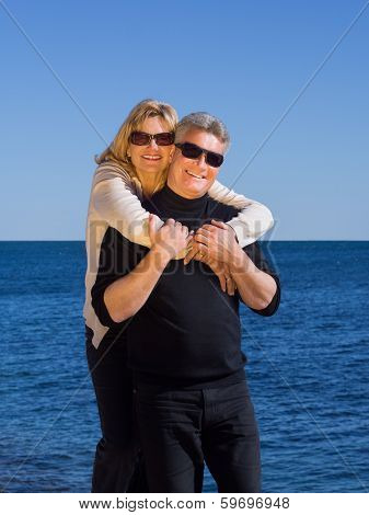 Happy Loving Middle-aged Couple On Beach