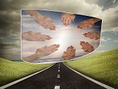 Hands together on abstract screen against highway under cloudy sky poster