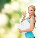 diet, sport and healthcare concept - beautiful sporty woman with scale and green apple poster